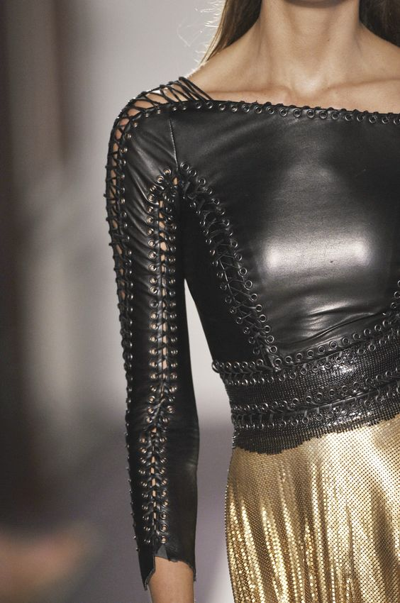 Faux leather top with eyelets
