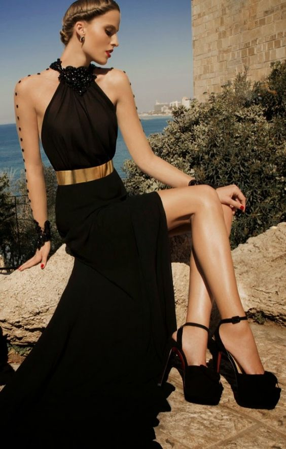 Gold metal belt with black maxi dress