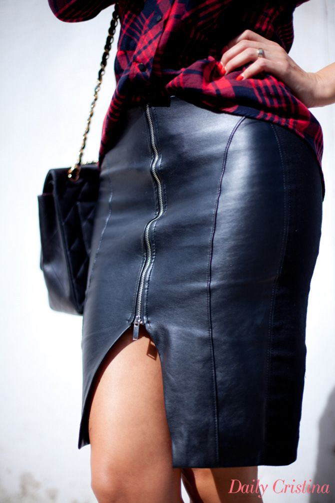 Silver zipper at front of leather skirt.