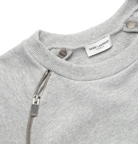 Sweater with exposed zippers