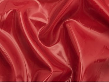 Metallic red latex sheeting.