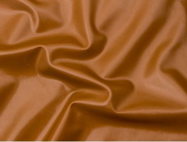 Thick bronze latex sheeting for corsets.
