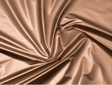 Metallic bronze vinyl fabric.