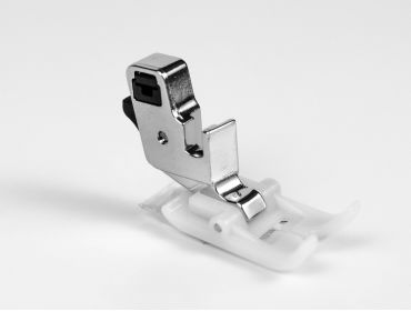 Teflon presser foot for sewing machines.