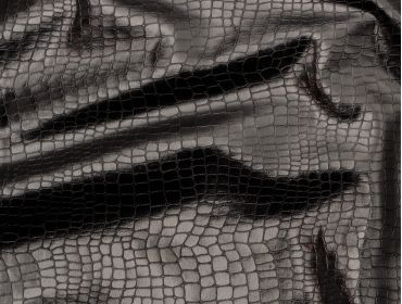 4-way stretch black snakeskin fabric.