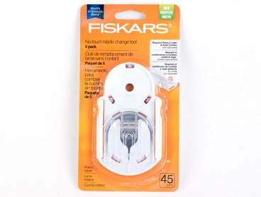 Fiskars hands free blade change tool with 5 pack of blades.