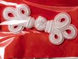White 3 knot oriental frog closure. thumbnail image.