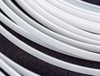 White plastic boning for corsetry by the yard. thumbnail image.