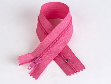 Hot pink 7 inch nylon teeth zipper.