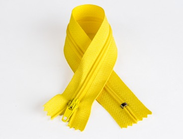 7 inch yellow zipper with nylon teeth.