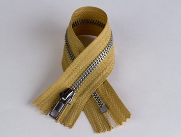 Gold hued aluminum zipper.