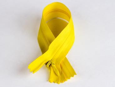 Yellow hidden concealed zipper.