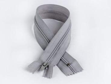 Grey non-separating zipper with nylon teeth.