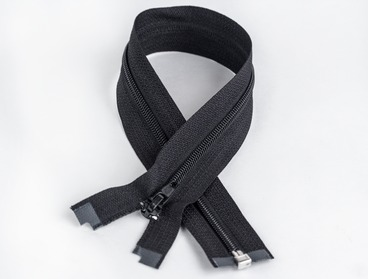 Black separating zipper with nylon teeth.