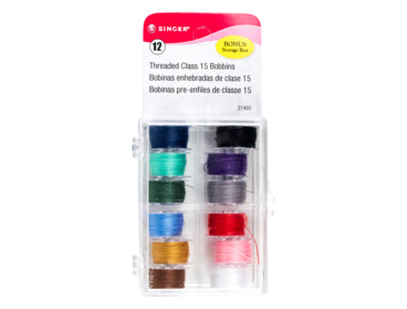 Pre-would bobbins in a variety of colors.