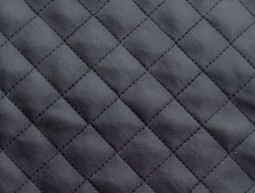 Black quilted faux leather fabric.