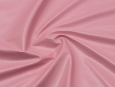 Baby pink four way stretch vinyl fabric.