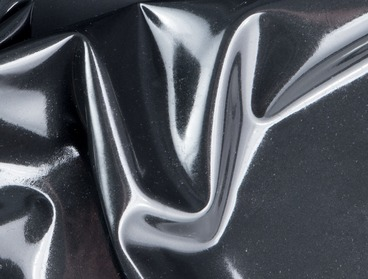 Shiny metallic black latex sheeting.