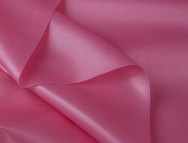 Metallic pink latex sheeting.