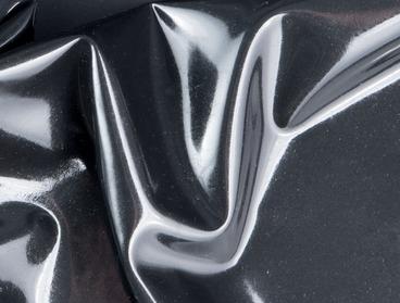 Shined up metallic black latex sheeting.