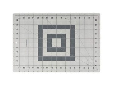 Fiskar 18x12 rotary cutting mat with grid.