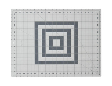 Fiskar 24x18 rotary cutting mat with grid.
