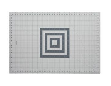 Fiskar 36x24 rotary cutting mat with grid.