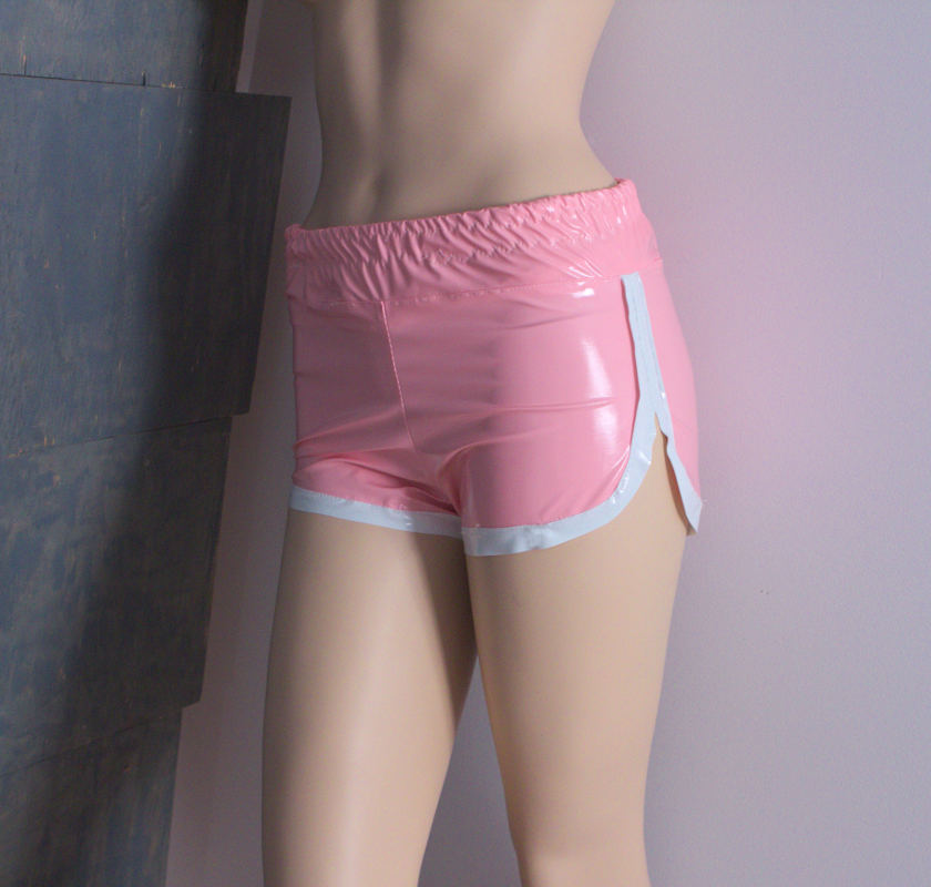 Model wearing faux leather barbie 80s retro shorts