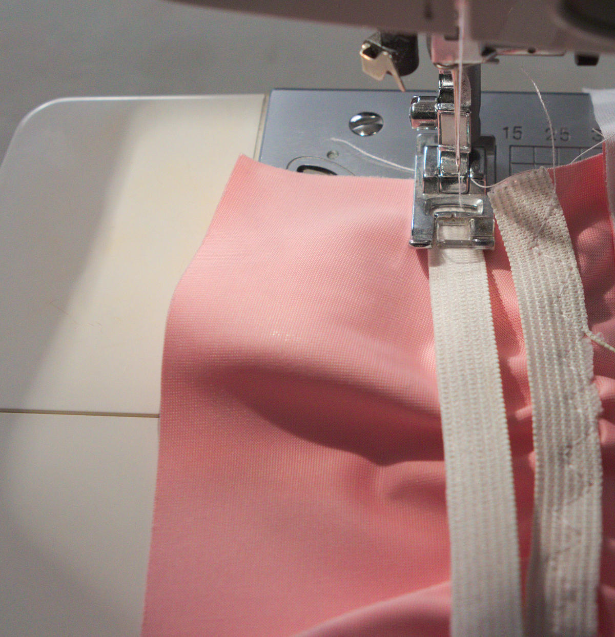 Sew elastic to waistband.